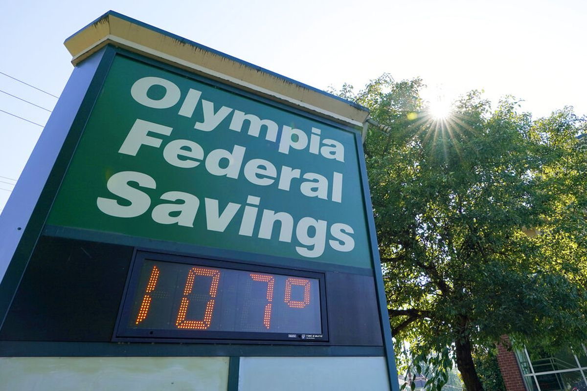 A display at an Olympia Federal Savings branch in Washington state shows a temperature of 107 degrees Fahrenheit.