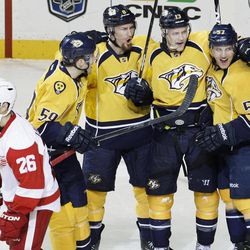 Nashville Predators forward Gabriel Bourque (57) celebrates his second goal of the game with teammates Roman Josi (59), of Switzerland, Kevin Klein (8) and Nick Spaling (13) as Detroit Red Wings left wing Jiri Hudler (26), of the Czech Republic, skates past in the third period of Game 1 of a first-round NHL hockey playoff series on Wednesday, April 11, 2012, in Nashville, Tenn. The Predators won 3-2.