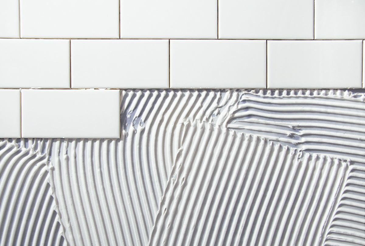 White Ceramic Subway Tile and Grout.