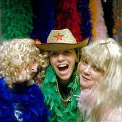 13-year-olds Shae Bennett and Kristen Stringham, left and center, and 12-year-old Karlie Vance, right, have fun dressing up as Barbies in blonde wigs and feather boas.
