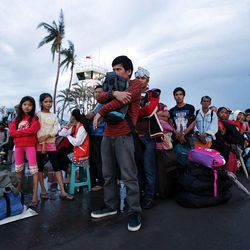 People wait at the airport in Tacloban, hoping to get transportation on a military airplane, Wednesday, Nov. 20, 2013.