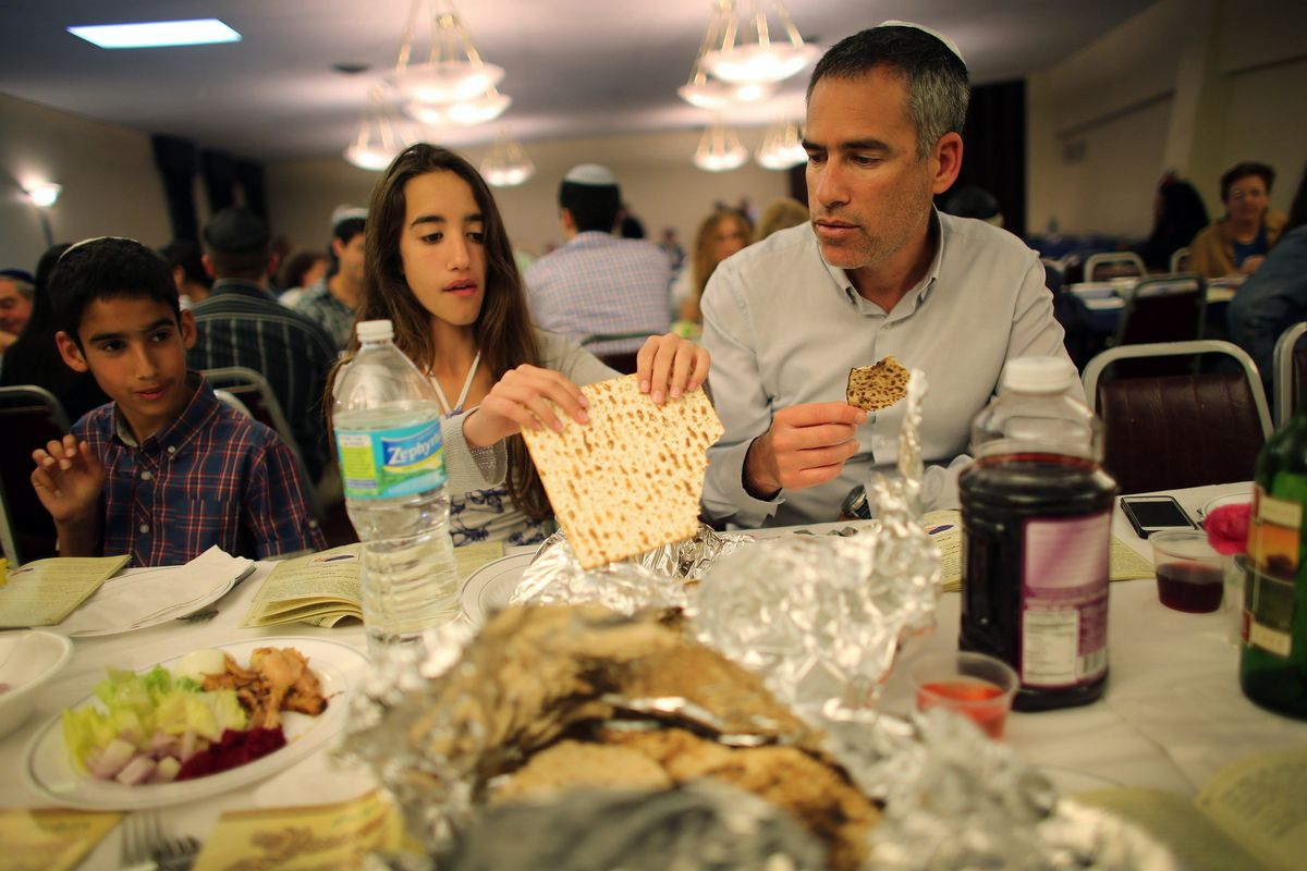 Jewish families attend a communal Passover seder in Miami Beach, Florida
