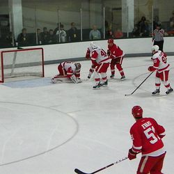 Jared Coreau covers the puck while Xavier Ouellet and Ryan Sproul guard the crease from the mighty Abdelgator