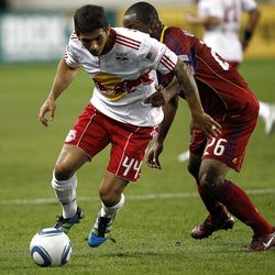 HARRISON, NJ - SEPTEMBER 21:  Carlos Mendes #44 of the New York Red Bulls moves the ball away from Collen Warner #26 of the Real Salt Lake during their game at Red Bull Arena on September 21, 2011 in Harrison, New Jersey.  (Photo by Jeff Zelevansky/Getty Images)