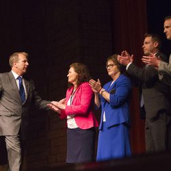 Newly selected 3rd District candidate gives one last speech with the support of his wife and the other candidates at Timpview High School Provo on Saturda7, June 17, 2017.