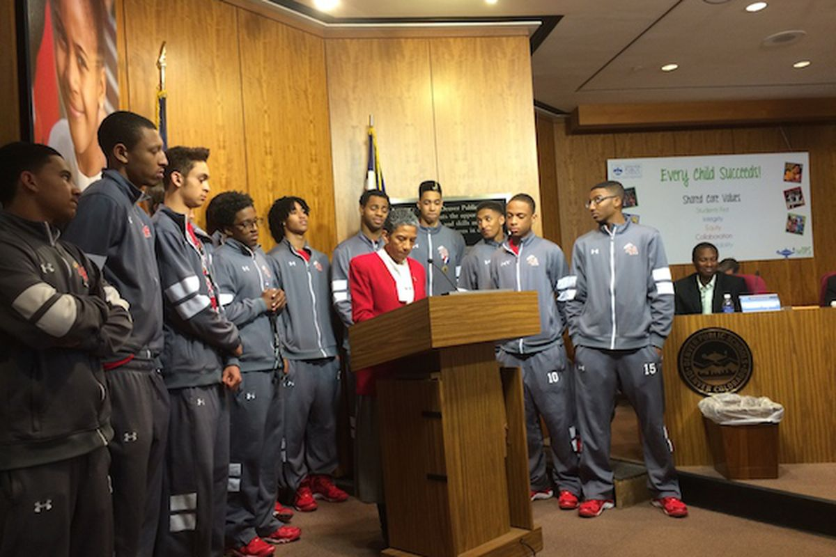 Denver Public Schools Board President Happy Haynes, center, in March recognized the East High School boy's basketball team for winning the state's championship tournament. Under Haynes' leadership Denver's school board has displayed few disagreements in public.