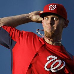 FILE - In this March 20, 2012 file photo, Washington Nationals starting pitcher Stephen Strasburg warms up between innings in a spring training baseball game against the New York Mets in Port St. Lucie, Fla. Strasburg is getting prepared to do something he never has before: be an opening-day starter.