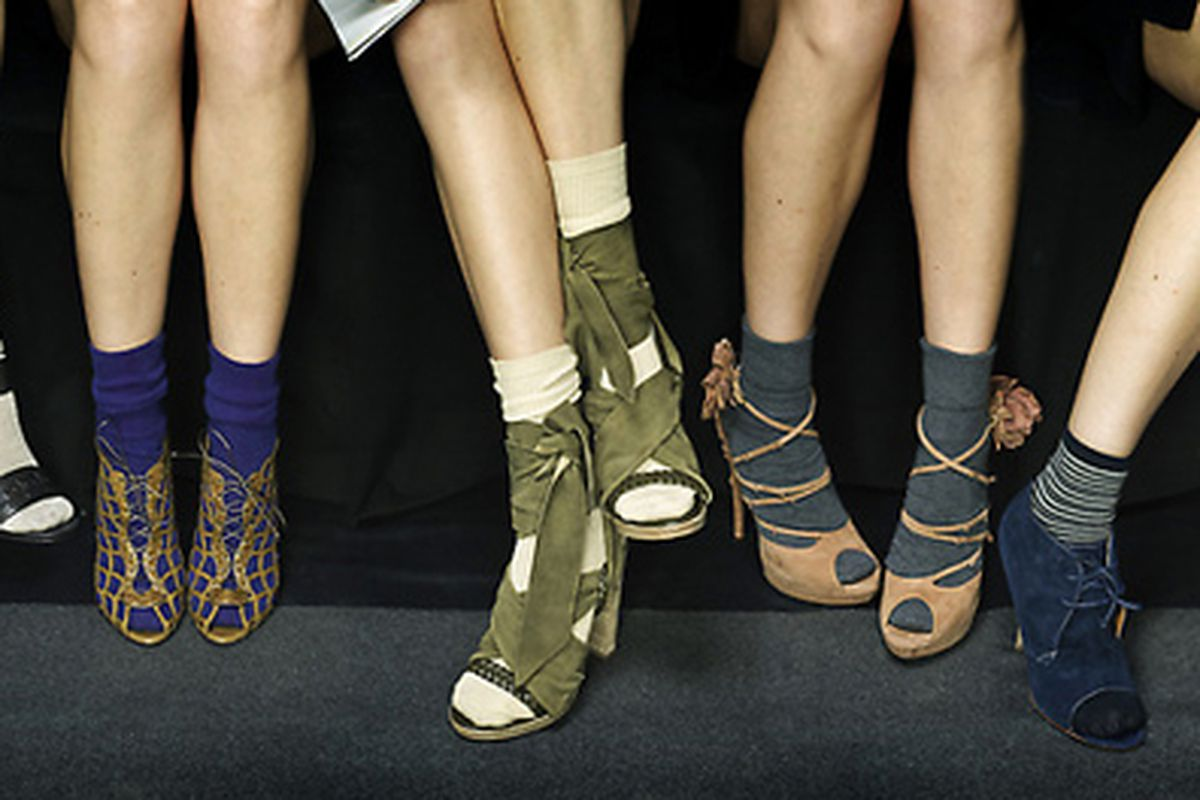 """Sure, it looks passable on the models, but can a real mortal pull off the socks-and-sandals combo? Image via <a href=""""http://www.nytimes.com/2010/02/11/fashion/11POINTS.htm"""">NYT</a>."""