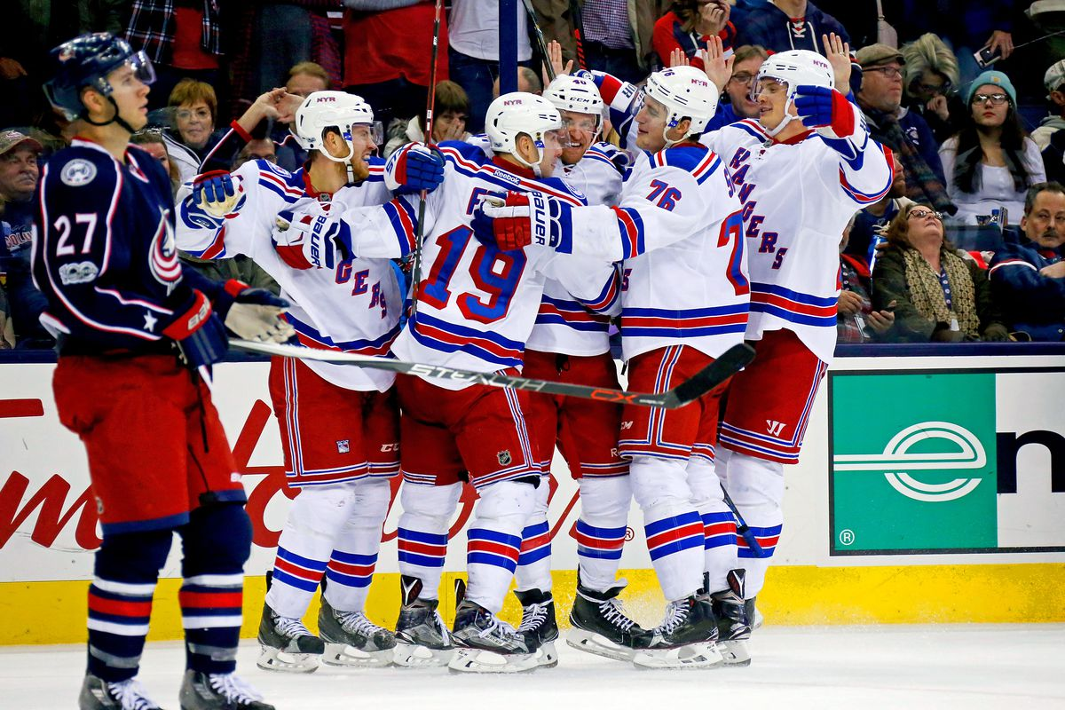 COLUMBUS, OH - JANUARY 7: Michael Grabner #40 of the New York Rangers is congratulated by his teammates after scoring the game winning goal during the third period of the game against the Columbus Blue Jackets on January 7, 2017 at Nationwide Arena in Columbus, Ohio. New York defeated Columbus 5-4. (Photo by Kirk Irwin/Getty Images)