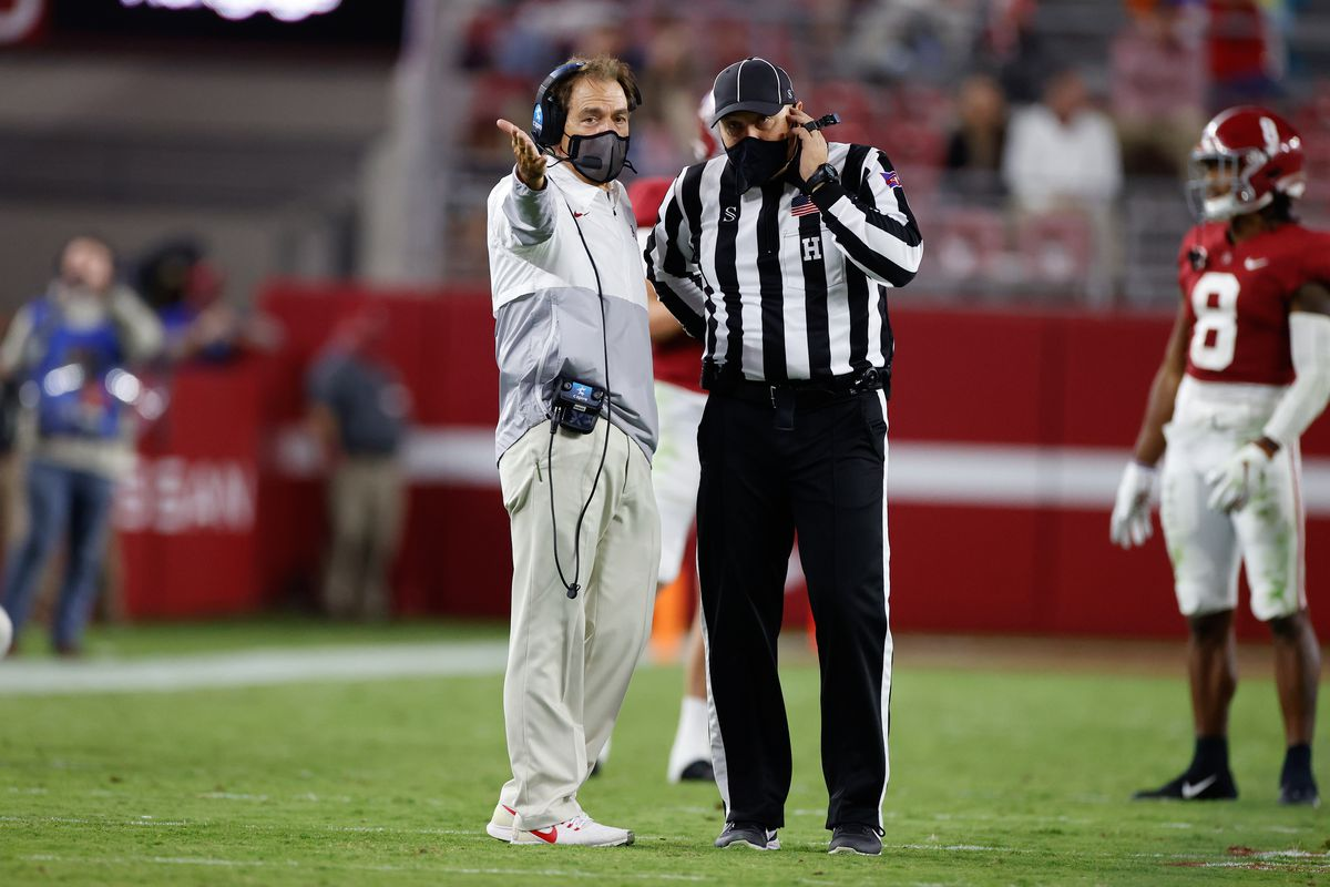 Head coach Nick Saban of the Alabama Crimson Tide discusses a play with an official during the game against the Mississippi State Bulldogs at Bryant-Denny Stadium on October 31, 2020 in Tuscaloosa, Alabama.
