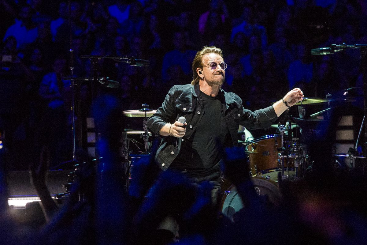 Bono with U2 performs at the United Center in 2018.