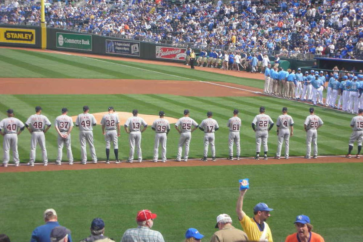 The Detroit Tigers line up along the third base line before the season opener on Monday.