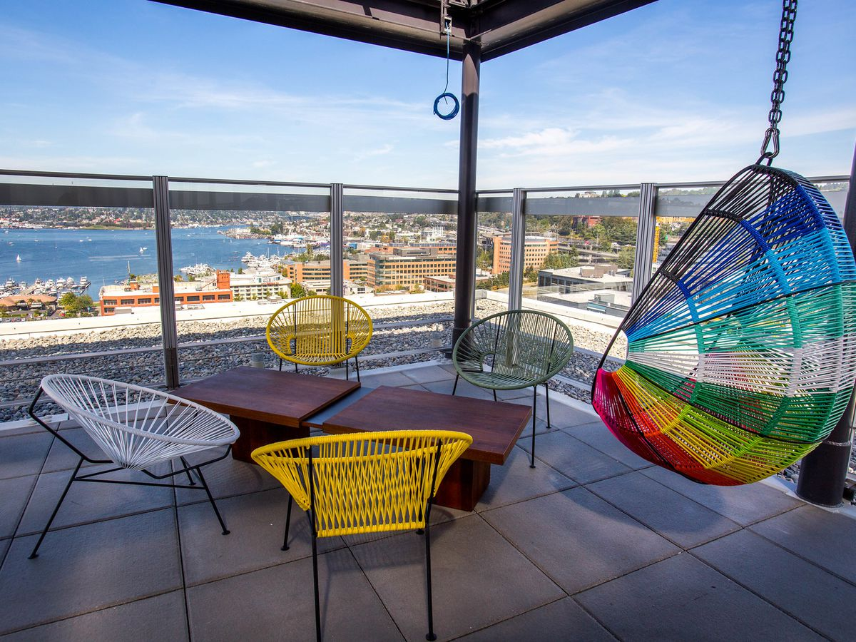 The outdoor patio at Mbar, with colorful furniture and a view of Lake Union.