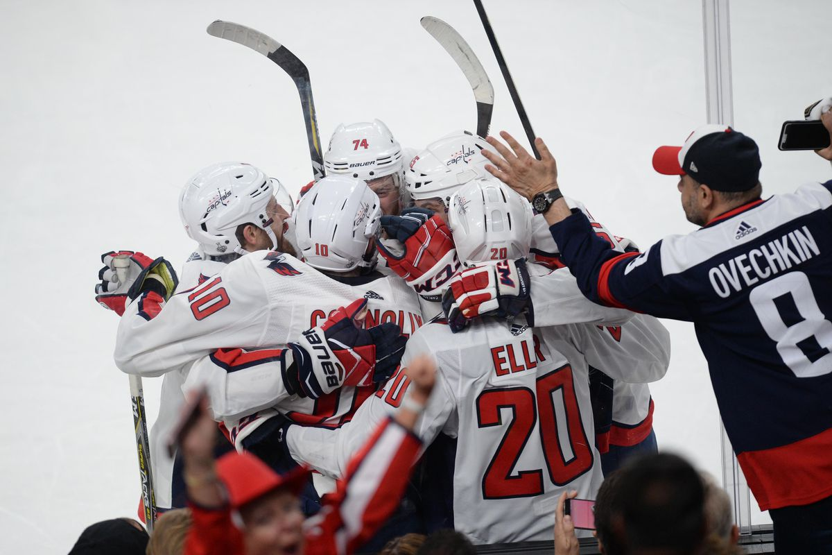 7bbdca825d6 Washington Capitals center Lars Eller (20) celebrates with teammates after  scoring the game-winning goal Gary A. Vasquez-USA TODAY Sports