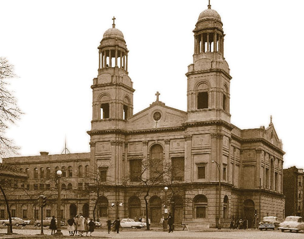 Corpus Christi Church around the mid-20th century. The twin bell towers were removed in 2004.