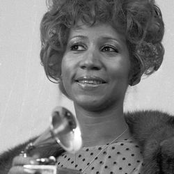 """Aretha Franklin holds her Grammy Award for """"Bridge Over Troubled Waters."""" 