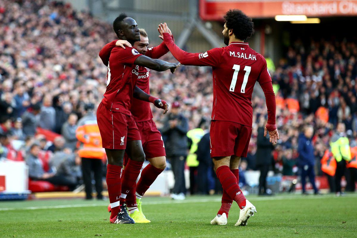 Sadio Mane (left) celebrates with teammates - Liverpool FC - Premier League