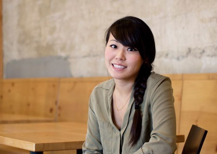 Vivian Ku sits at one of the tables of her restaurant Pine & Crane in Silver Lake.