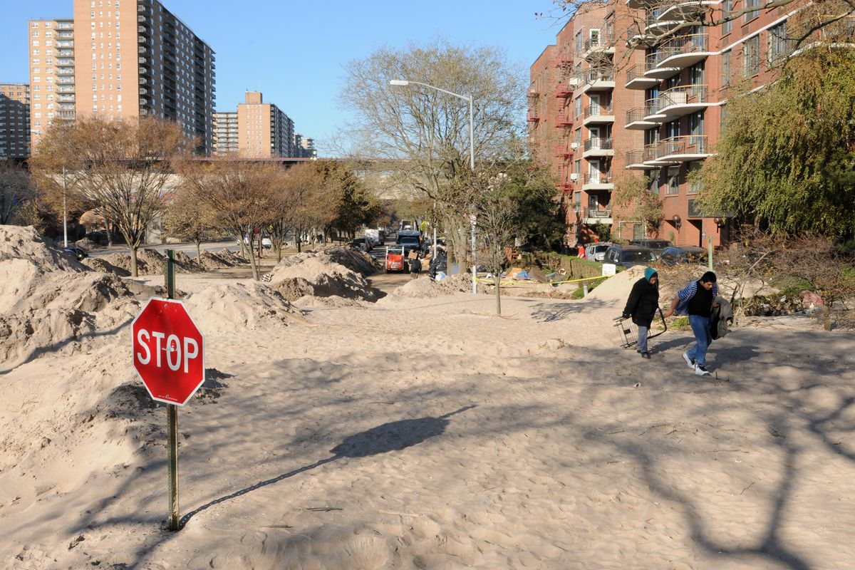 Hurricane Sandy carried tons of sand over the Boardwalk in Coney Island and Brighton Beach, Nov. 11, 2021.