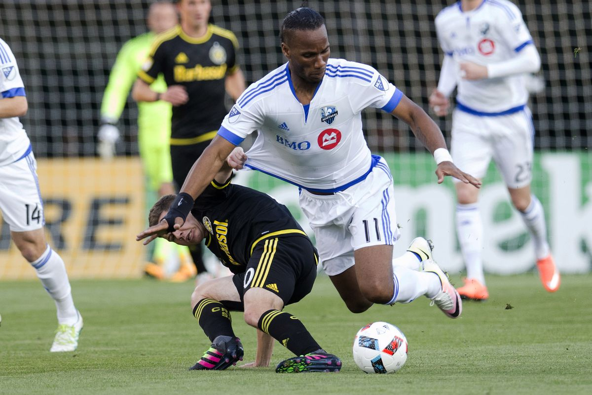 Didier Drogba goes down after a heavy challenge in IMFC's wild, 4-4 draw with the Crew on Saturday.