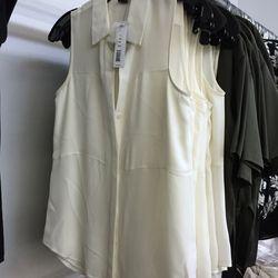 White button-down sleeveless blouse, $89 (was $190)
