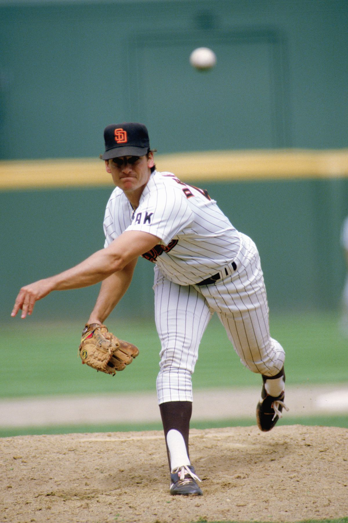 Dave Dravecky throws the pitch