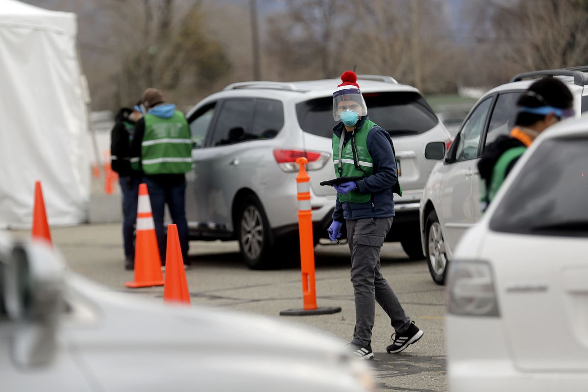 People in cars line up for COVID-19 testing outside of the Maverik Center in West Valley City on Tuesday, Dec. 22, 2020.Rochelle Walensky, director of the Centers for Disease Control and Prevention, said she's worried about another surge that doens't need to happen.