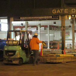 5:47 p.m. Forklift operator moving a pallet, outside of Gate D -