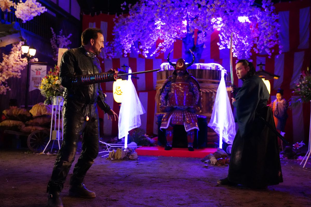 A sword-handed Nic Cage fights a samurai in Prisoners of the Ghostland