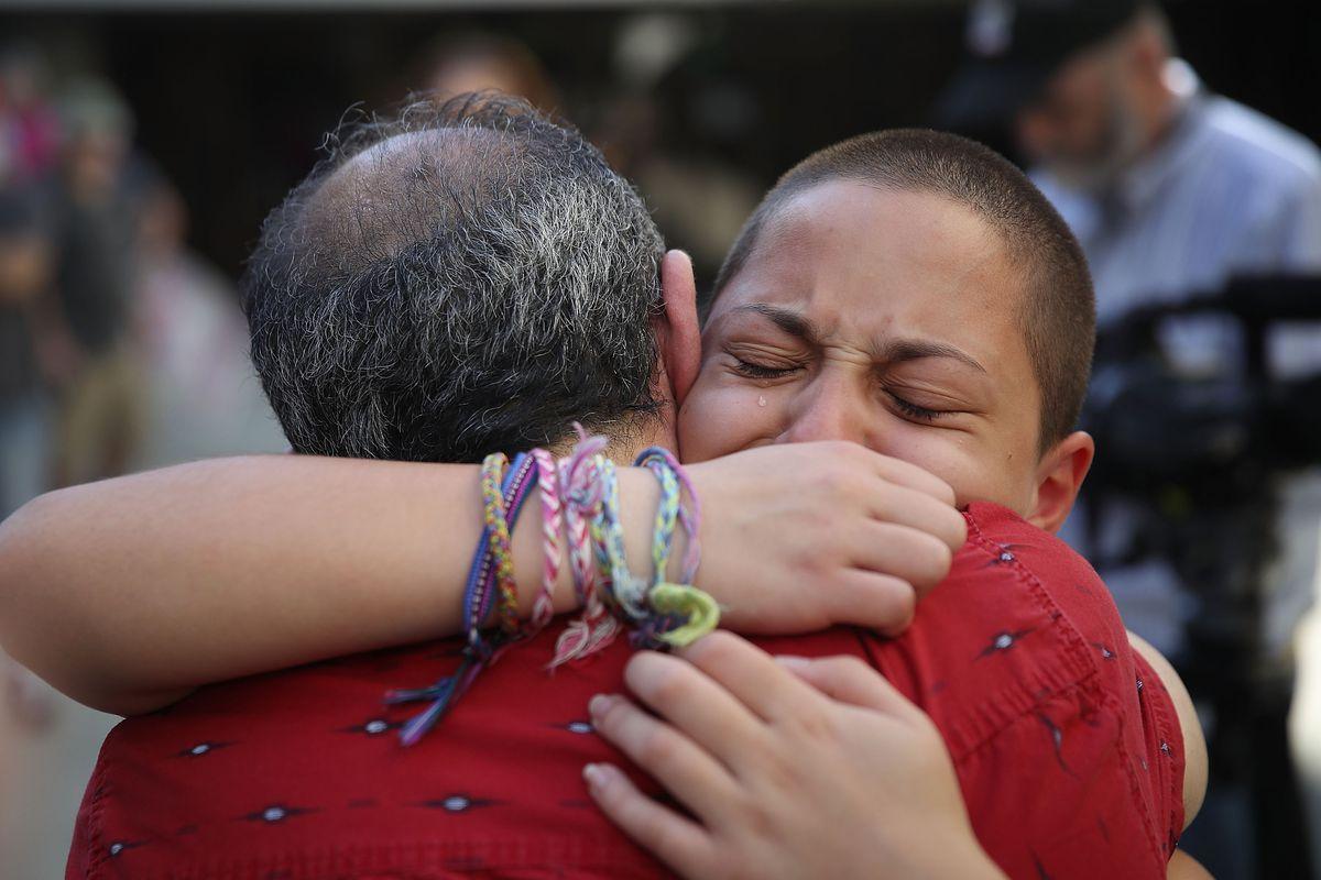 A Parkland shooting survivor hugs her father