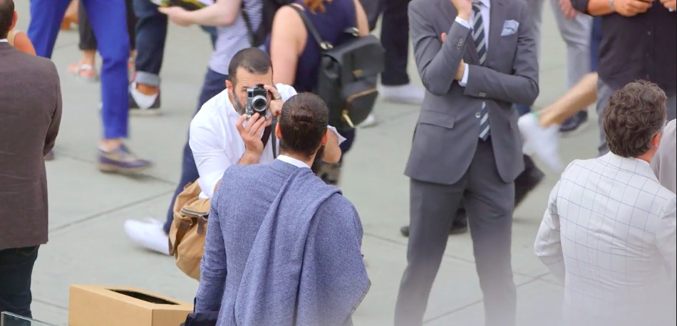 Man being photographed at Italy's Pitti Uomo