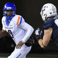 Boise State quarterback Jaylon Henderson (9) looks for a receiver as Utah State defensive end Jacoby Wildman (93) pursues during the first half of an NCAA college football game Saturday, Nov. 23, 2019, in Logan, Utah.