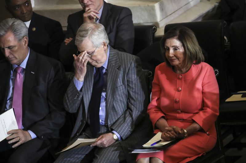 Speaker of the House Nancy Pelosi and Senate Majority Leader Mitch McConnell attend a Congressional Gold Medal ceremony at the U.S. Capitol on Jan. 15.