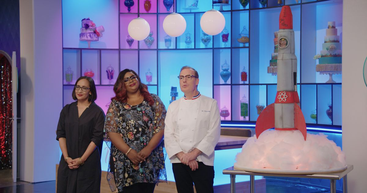 Three judges and a giant rocket cake