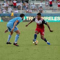 Santiago Mosquera (11) uses his foot skills to get past New York City FC defender Eric Miller (5) in the second half of the match.
