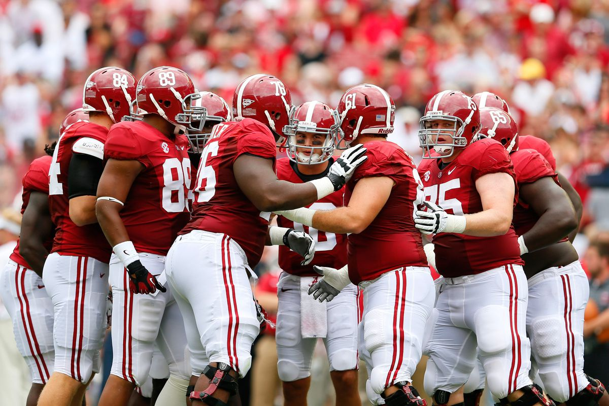 TUSCALOOSA, AL - SEPTEMBER 08:  AJ McCarron #10 of the Alabama Crimson Tide huddles the offense against the Western Kentucky Hilltoppers at Bryant-Denny Stadium on September 8, 2012 in Tuscaloosa, Alabama.  (Photo by Kevin C. Cox/Getty Images)