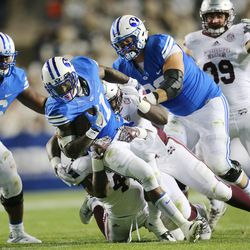 Brigham Young Cougars running back Jamaal Williams (21) is tackled during a run as BYU and Mississippi State play in Provo at LaVell Edwards Stadium on Friday, Oct. 14, 2016.