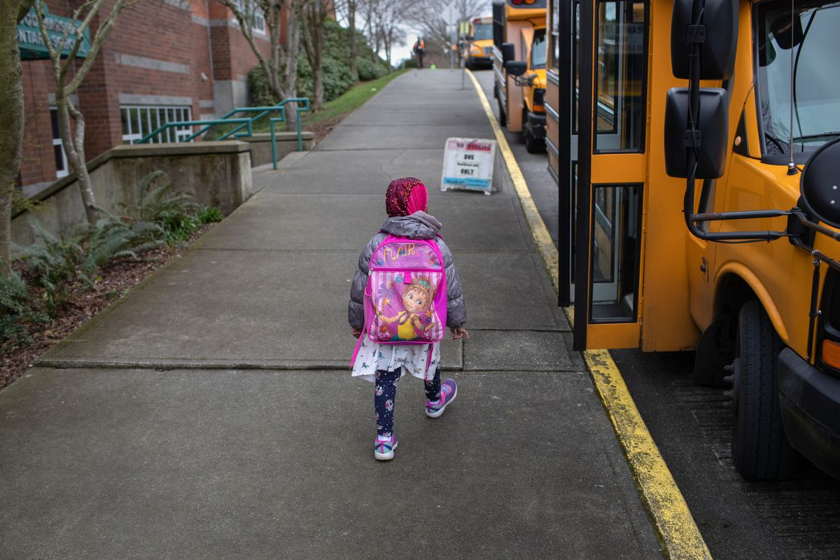 A student leaves a school in Seattle, where coronavirus fears have led to school closures. Across the country, the virus is prompting schools to rethink their attendance policies.