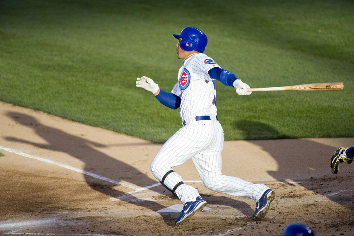Darwin Barney of the Chicago Cubs follows through on a solo home run during the first inning against the Milwaukee Brewers at Wrigley Field in Chicago, Illinois.  (Photo by Brian Kersey/Getty Images)