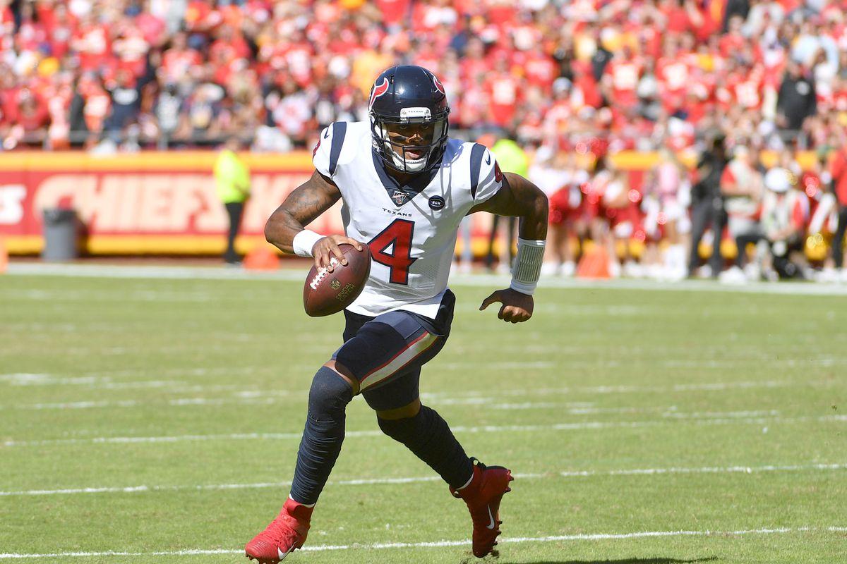 Houston Texans quarterback Deshaun Watson runs the ball against the Kansas City Chiefs during the first half at Arrowhead Stadium.