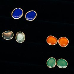 """<a href=""""http://shopthemansion.com/collections/jewelry/products/14k-lapis-studs"""">14k lapis</a> studs ($335); <a href=""""http://shopthemansion.com/collections/jewelry"""">14k labradorite</a> studs ($365); <a href=""""http://shopthemansion.com/collections/jewelry/p"""