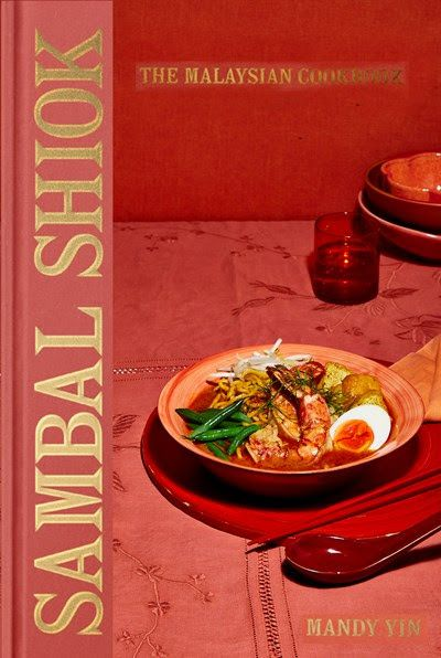A red cookbook cover with a bowl of Malaysian food and the words Sambal Shiok: The Malaysian Cookbook