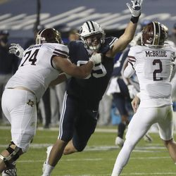 Brigham Young Cougars defensive lineman Fisher Jackson (59) hurries Texas State Bobcats quarterback Brady McBride (2) in Provo on Saturday, Oct. 24, 2020.