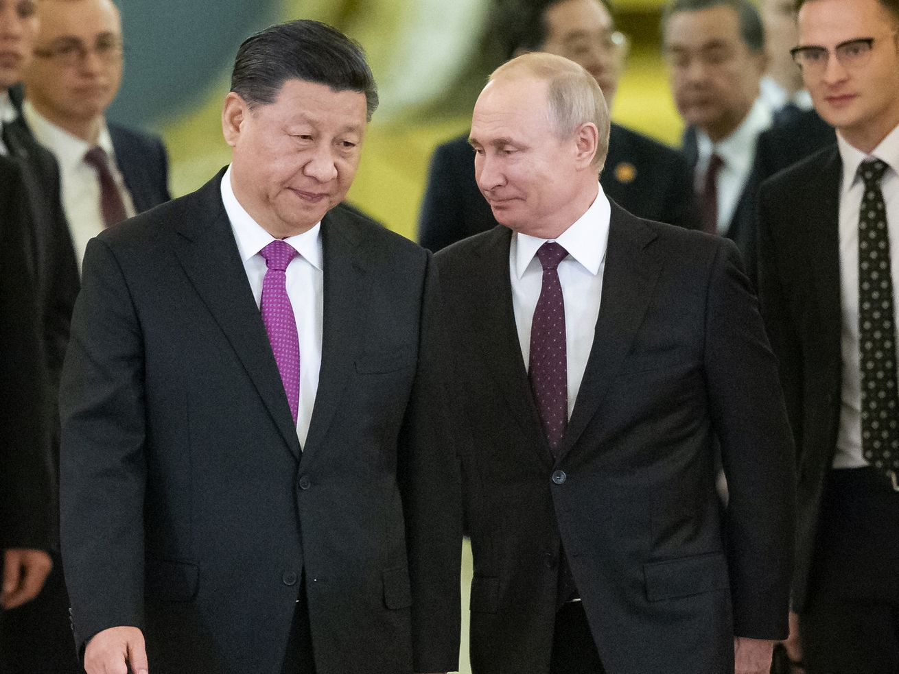 """In this June 5, 2019, file photo, Russian President Vladimir Putin, center right, and Chinese President Xi Jinping, center left, enter a hall for talks in the Kremlin in Moscow, Russia. Putin and Xi have developed strong personal ties helping bolster a """"strategic partnership"""" between the two former Communist rivals."""