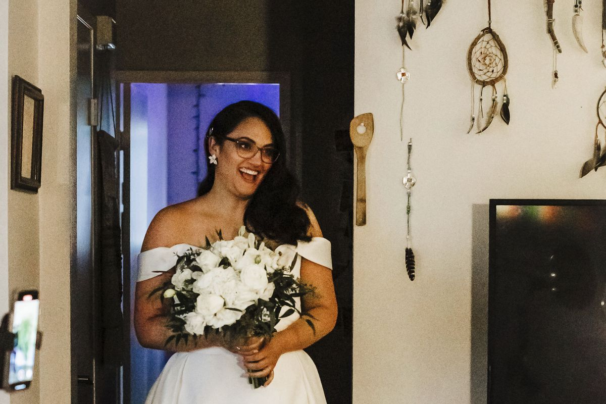 This Sunday, Dec. 27, 2020 photo provided by Kristen Pritchard Photography shows Kayleigh during her home wedding to Cody Cousins.