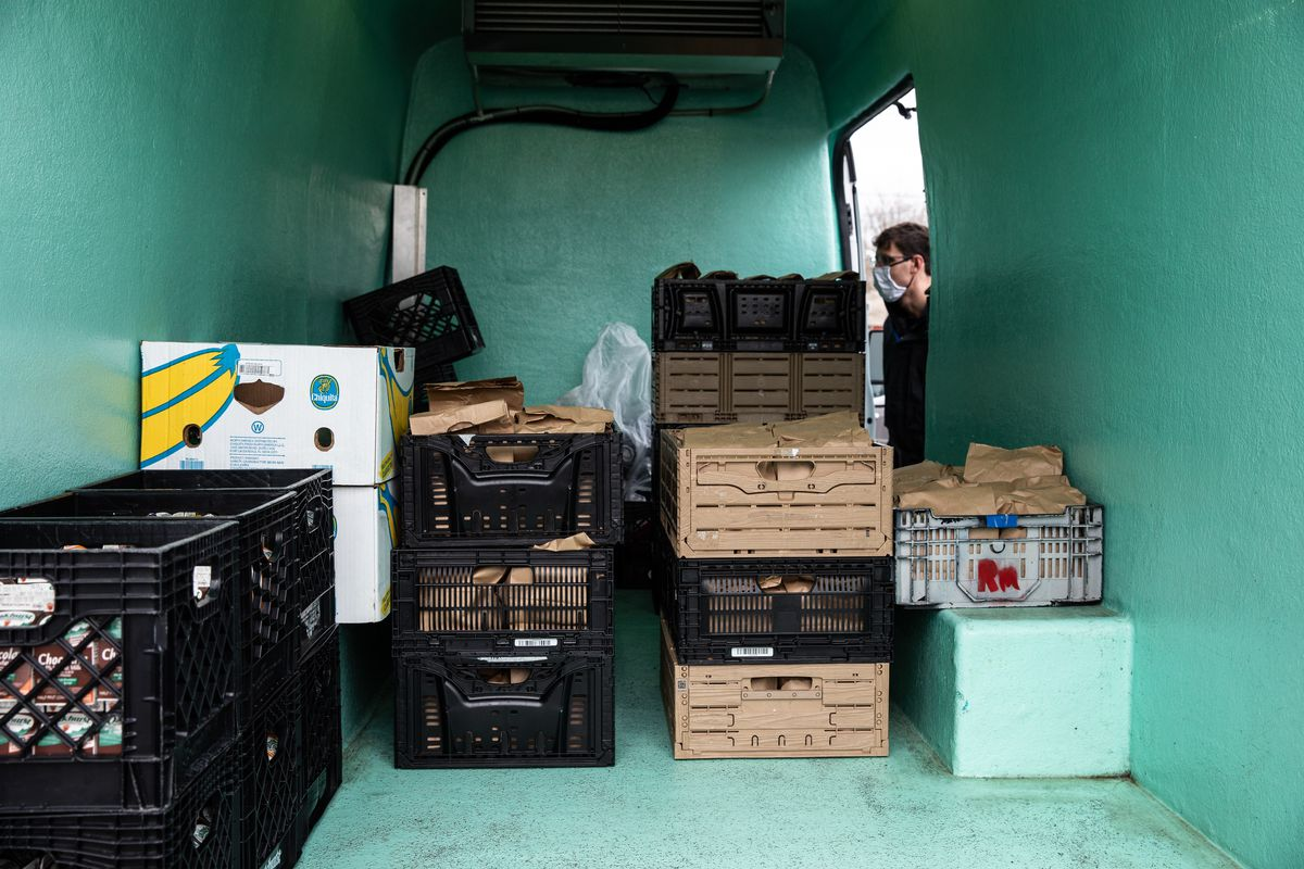 The inside of a van filled with crates