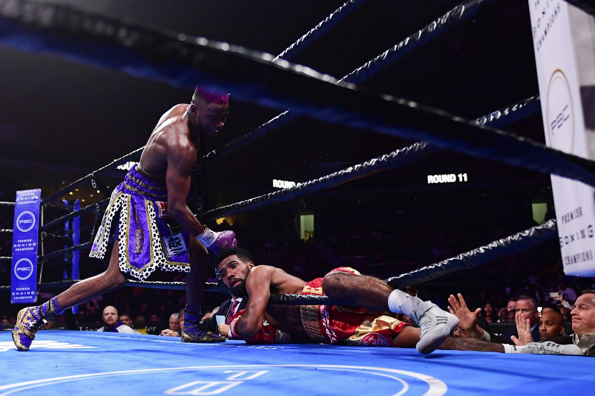 Chris Colbert (L) punches Jezreel Corrales out of the ring as Corrales loses his footing during the eleventh round at The Liacouras Center at Temple University on January 18, 2020 in Philadelphia, Pennsylvania.