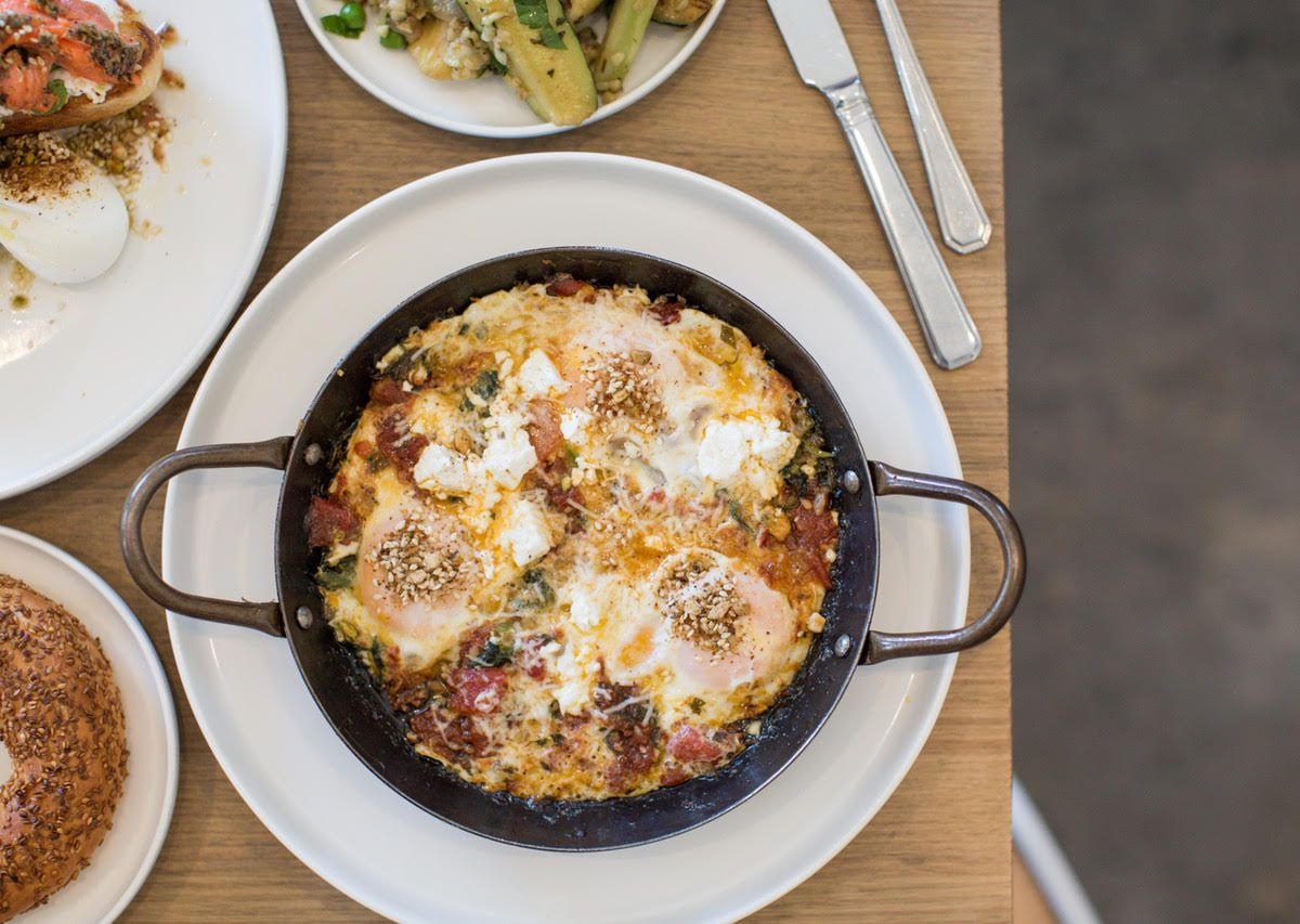 A cast iron pan of baked eggs at Babajan