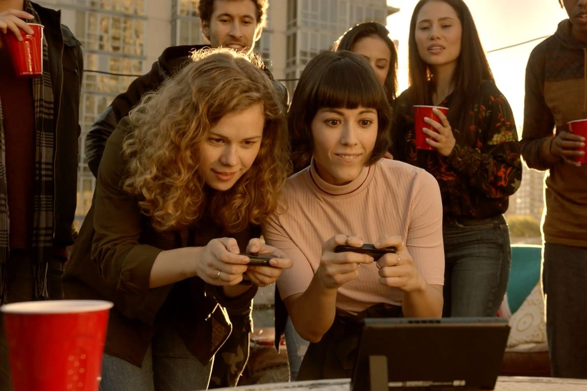 Nintendo Switch - 'Karen' playing switch on rooftop