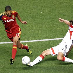 Alvaro Saborio of Real Salt Lake fights to control the ball against Dejan Jakovic of DC United during their MLS matchup at Rio Tinto Stadium in Sandy Saturday, September 1, 2012